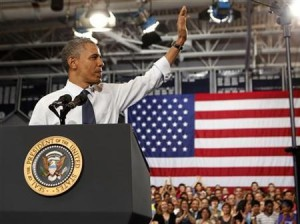 U.S. President Obama waves to students at Washington-Lee High School in Virginia