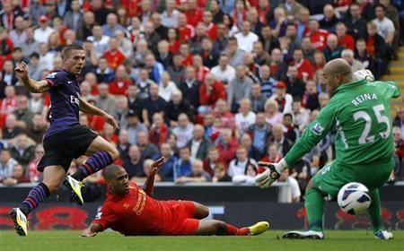 Podolski on target as Arsenal cruise past Liverpool