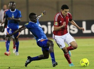 Gedo of Egypt's Al-Ahly fights for the ball with Yunusa of Nigeria's Sunshine Stars during their African Champions League semi-final soccer match at the Military Stadium in Cairo