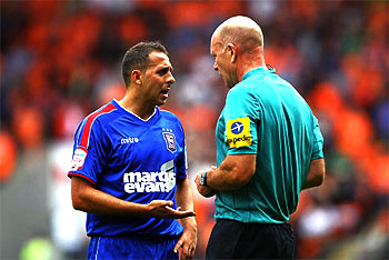 Ipswich striker; Chopra charged for race fixing