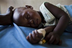A young girl with malaria rests in the inpatient ward of the Malualkon Primary Health Care Center in Malualkon