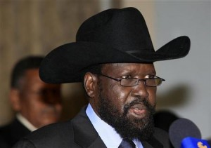 South Sudanese President Kiir speaks during a news conference with his Sudanese counterpart al-Bashir at Khartoum Airport