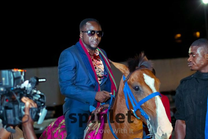 PHOTO: Price Tillaman Rides Into Party On Horseback