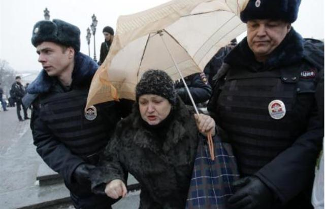 Russian Police Detain Dozens For Umbrella Protest