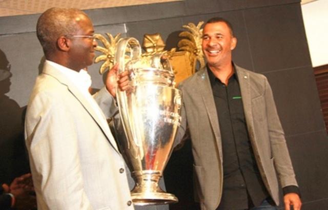 Fashola Receives UEFA Champions League Trophy, Ruud Gullit In Lagos