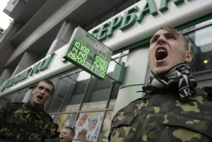 Members of Ukrainian self-defence units hold a rally outside an office of Russia's Sberbank, in Kiev