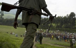 An FDLR soldier walks toward a distribution center near Lushubere Camp in Masisi in the DRC