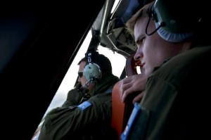Handout photo of RAAF pilots looking from the cockpit of an RAAF AP-3C Orion aircraft during the search for MH370 in the southern Indian Ocean