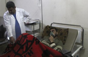 A man breathes through an oxygen mask inside a field hospital in Kfar Zeita village in the central province of Hama