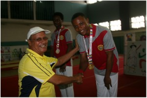 Monday Uba of Lagos Island West (right) receiving gold medal won in Gymnastics from Mr Babatunde Fatayi-Williams