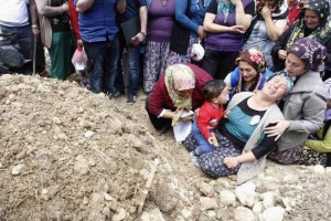 Women mourn during the funeral of a miner who died in a fire at a coal mine, at a cemetary in Soma, a district in Turkey's western province of Manisa