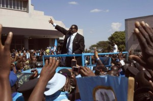 Malawi's President Mutharika of the Democratic Progressive Party waves to supporters after he was sworn in in Blantyre