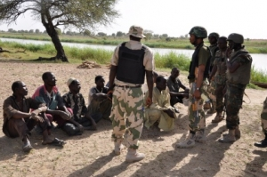 Troops interrogating some arrested terrorists