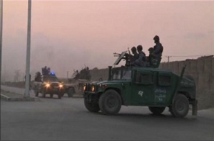 Video still shows Afghan security personnel on vehicles as an area near the Kabul airport comes under attack