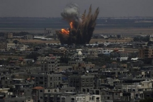 Smoke and flames are seen following what police said was an Israeli air strike in Rafah in Gaza Strip