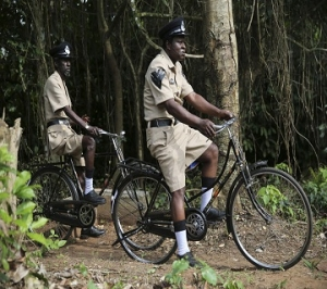Actors Sadiq Daba and Aderupoko ride bicycles as they perform during filming for 'October 1', at a rural location in Ilaramokin village, southwest Nigeria