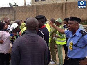 Police official addressing a voter. Security during elections