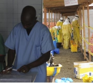 MSF health workers prepare at ELWA's hospital isolation camp during the visit of Senior U.N. System Coordinator for Ebola, Nabarro, in Monrovia