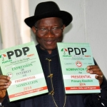 Goodluck Jonathan with party nomination form.