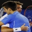Djokovic of Serbia hugs Wawrinka of Switzerland after winning their men's singles semi-final match at the Australian Open 2015 tennis tournament in Melbourne
