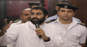 Activist Alaa Abdel Fattah speaks in front of a judge at an Egyptian Court during his trial