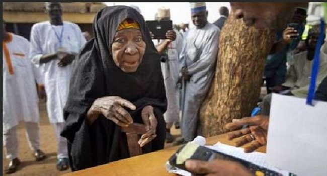 Elderly woman comes out to vote