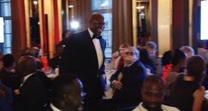 John Momoh walking to the podium