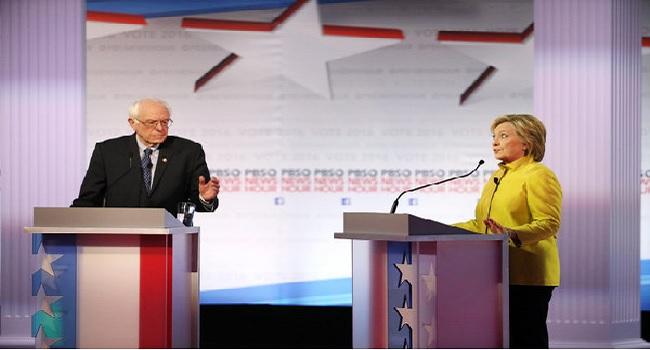 Hillary Clinton And Bernie Sanders Clash Over Obama In Debate
