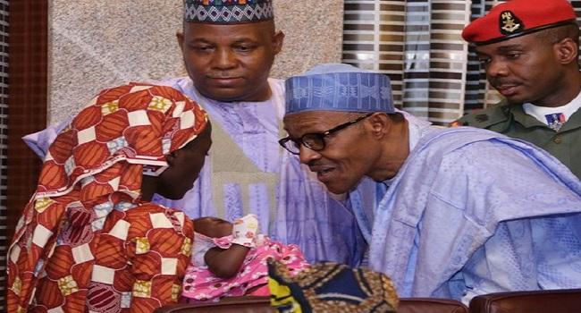President Buhari Meets Rescued Chibok Girl, Offers Scholarship