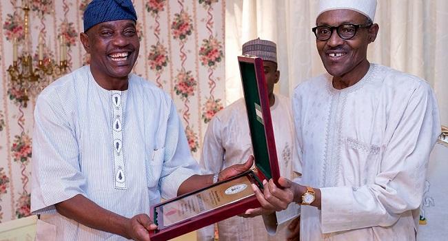 Solomon Arase and President Muhammadu Buhari