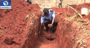 Police-taking-out-bullets-from-the-foundation