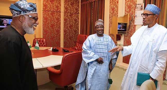 President Buhari having a chat with Governor Lalong and Mr Akeredolu