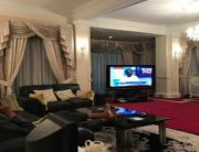President Buhari watching a programme on Channels TV