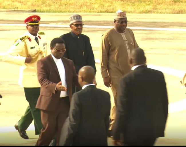 Buhari's entourage leading him to the Presidential Villa