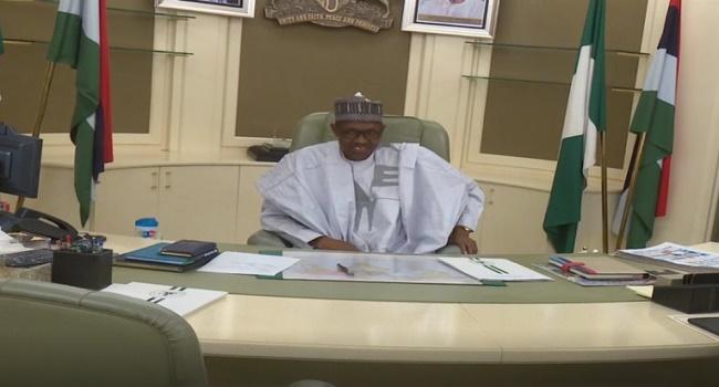 Buhari Smiling At His Office