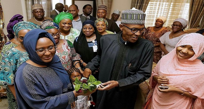 Buhari received by his wife, Aisha Buhari and well wishers