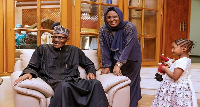 Buhari with his wife and grand-daughter