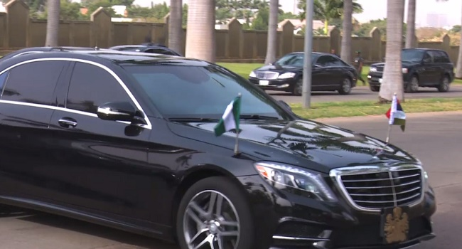 Buhari being driven to First Lady's conference Hall of the Presidential Villa
