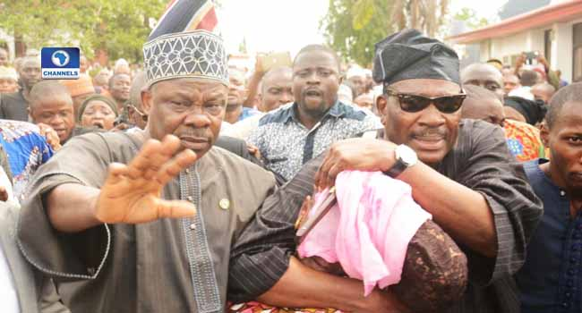 PHOTOS: Amosun Rescues Aregbesola's Aide From Angry Youths At Adeleke's Burial