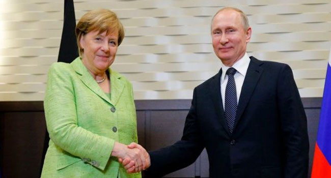 Merkel Meets Putin Over Syria, Ukraine Crisis