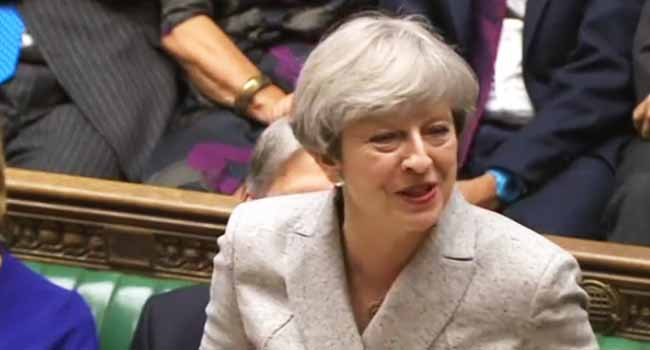 "May Promises ""Proper"" Investigation Into London Fire"