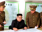 North Korea Releases Photos Of Kim Reviewing Guam Attack Plan