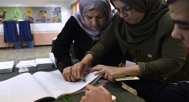 Algerians Vote In Low-Key Polls