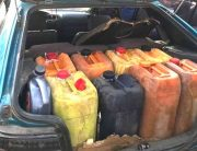 A file photo of petroleum products in plastic kegs.