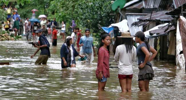 Three Dead, 77,000 Flee As Storm Ravages Philippines