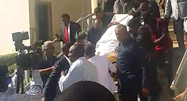 VIDEO: Olisa Metuh Wheeled To Court On Stretcher