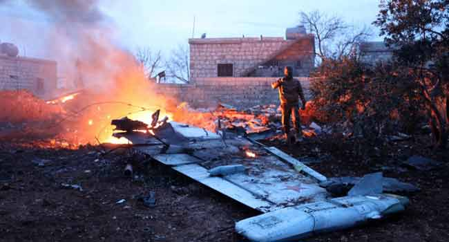 Russian Pilot 'Killed In Fighting' After Plane Downed In Syria