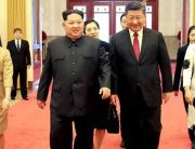 This picture from North Korea's official Korean Central News Agency (KCNA) taken on March 26, 2018 and released on March 28, 2018 shows China's President Xi Jinping (2nd R), his wife Peng Liyuan (R), North Korean leader Kim Jong Un (2nd L) and his wife Ri Sol Ju (L) walking in the Great Hall of the People in Beijing. KCNA VIA KNS / AFP