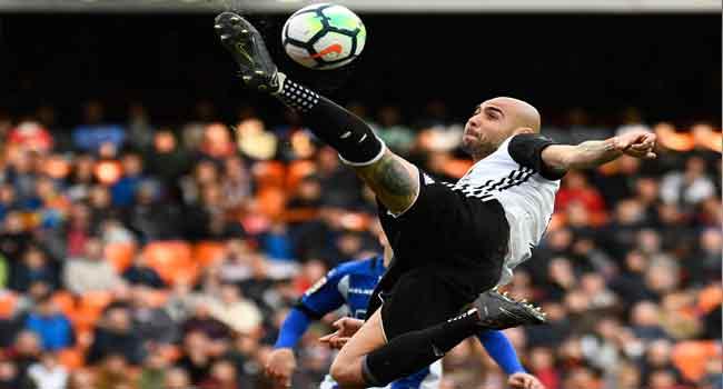 Valencia leapfrog Real Madrid