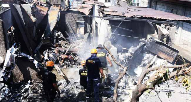 Ten Killed As Philippine Plane Crashes Into House